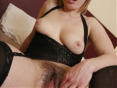 Magda is a sensual mature woman with a nice rack seducing a black dude into fucking her pussy live