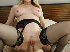 Hot mature pornstar Nina Hartley teases a younger guy into fucking her during a webcam show