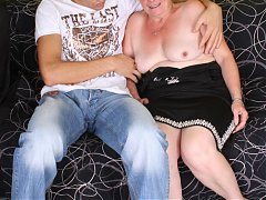 Pretty redhead Simone uses her long years of experience to seduce a younger guy into sex